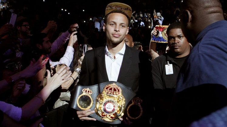 062015-boxing-stephen-curry-holds-andre-ward-wba-super-middle-weight-title-belt-mm-pi-vresize-1200-675-high-4